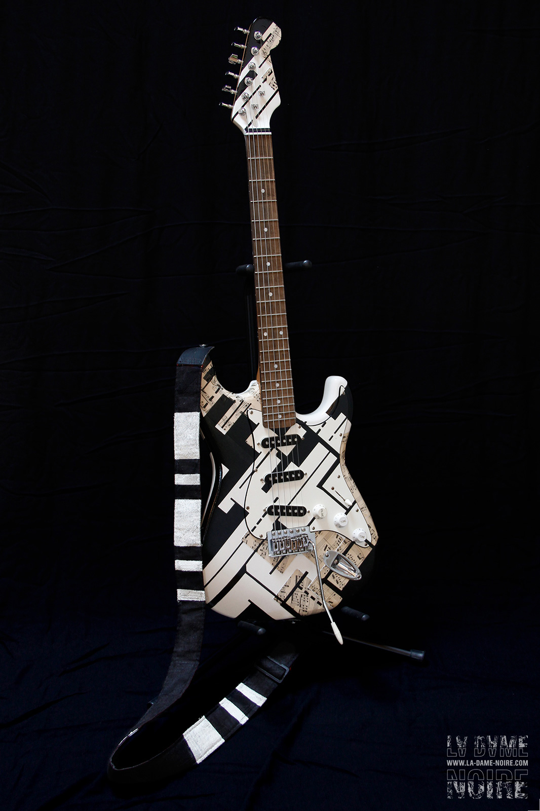 Electric guitar painted in black and white